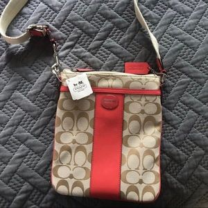 Coach crossbody bag. NEVER USED. Tags attached.